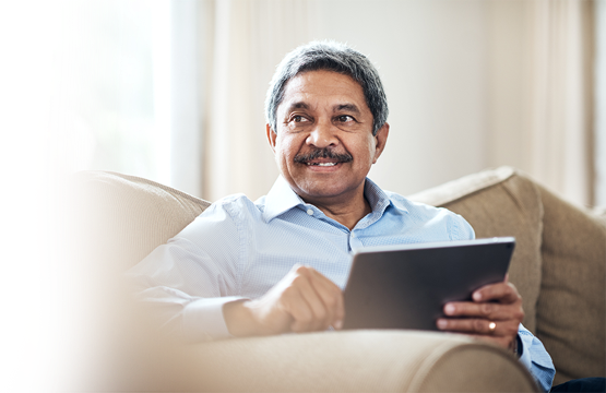 Man looking up Medicare Part D Prescription Drug plan options on his tablet